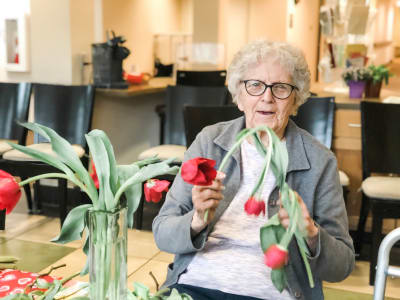 Arranging flowers at Bayberry Commons Assisted Living and Memory Care.