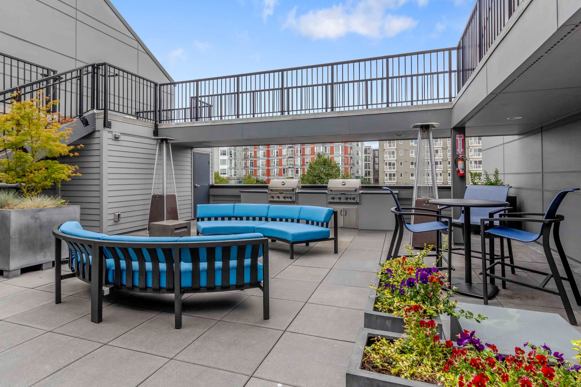 The community courtyard and barbecue stations at Elan 41 Apartments in Seattle, Washington