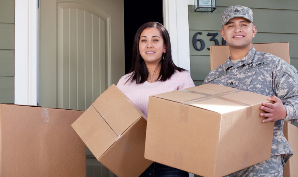 Military man and his girlfriend carrying boxes to Hallmark Mini Storage