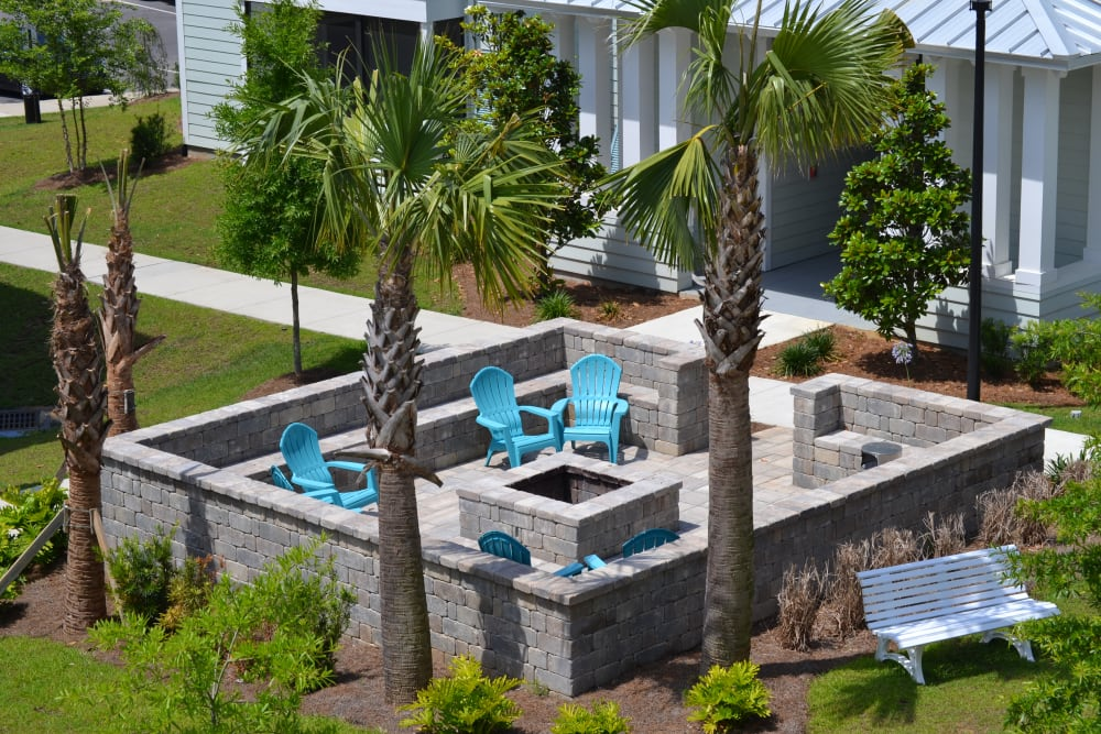 Outdoor seating around a fire pit at West Woods Apartments in Pensacola, Florida