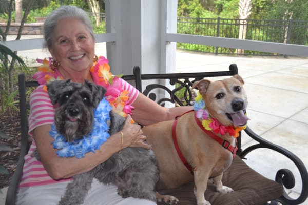 Resident of Edgewood Point Assisted Living in Beaverton, Oregon with her dogs
