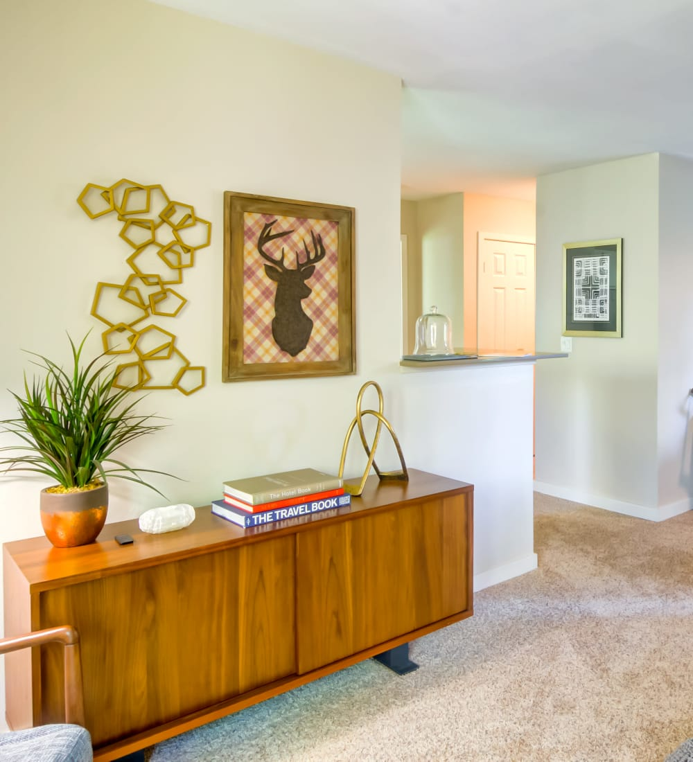 Plush carpeting and retro-modern furnishings in a model home's living area at Sofi at Murrayhill in Beaverton, Oregon