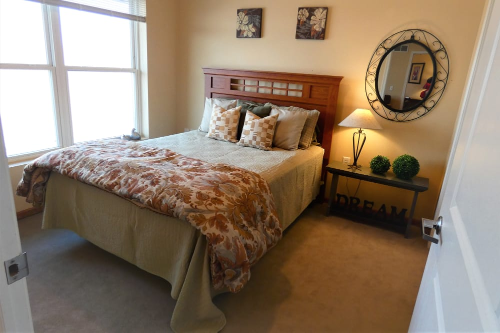 A cozy resident bedroom at The Lakeside Village in Panora, Iowa.