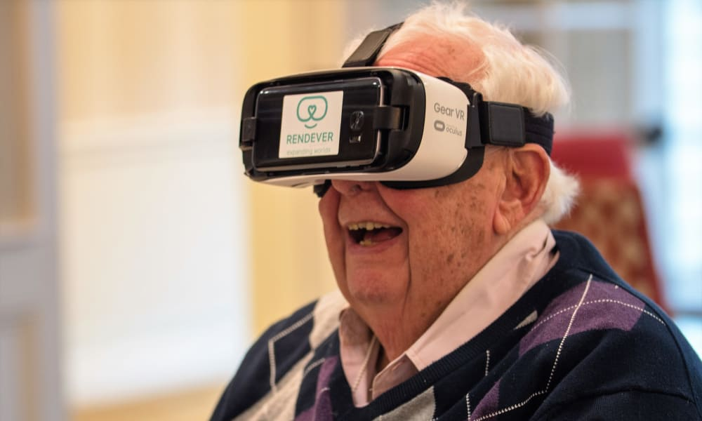 Resident enjoying a virtual reality experience at a Maplewood Senior Living community
