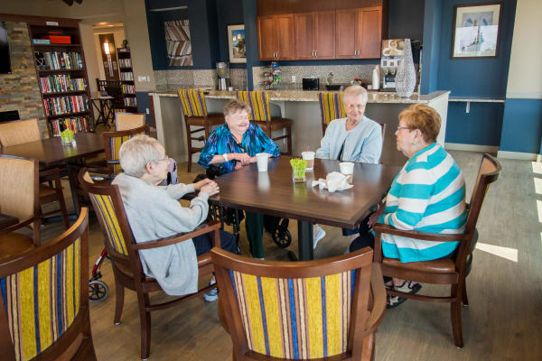 Residents gather in onsite bistro at First & Main of Commerce Township in Commerce Township, Michigan