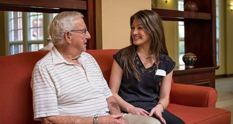 Caregiver talking with a resident at The Commons at Woodland Hills in Woodland Hills, California