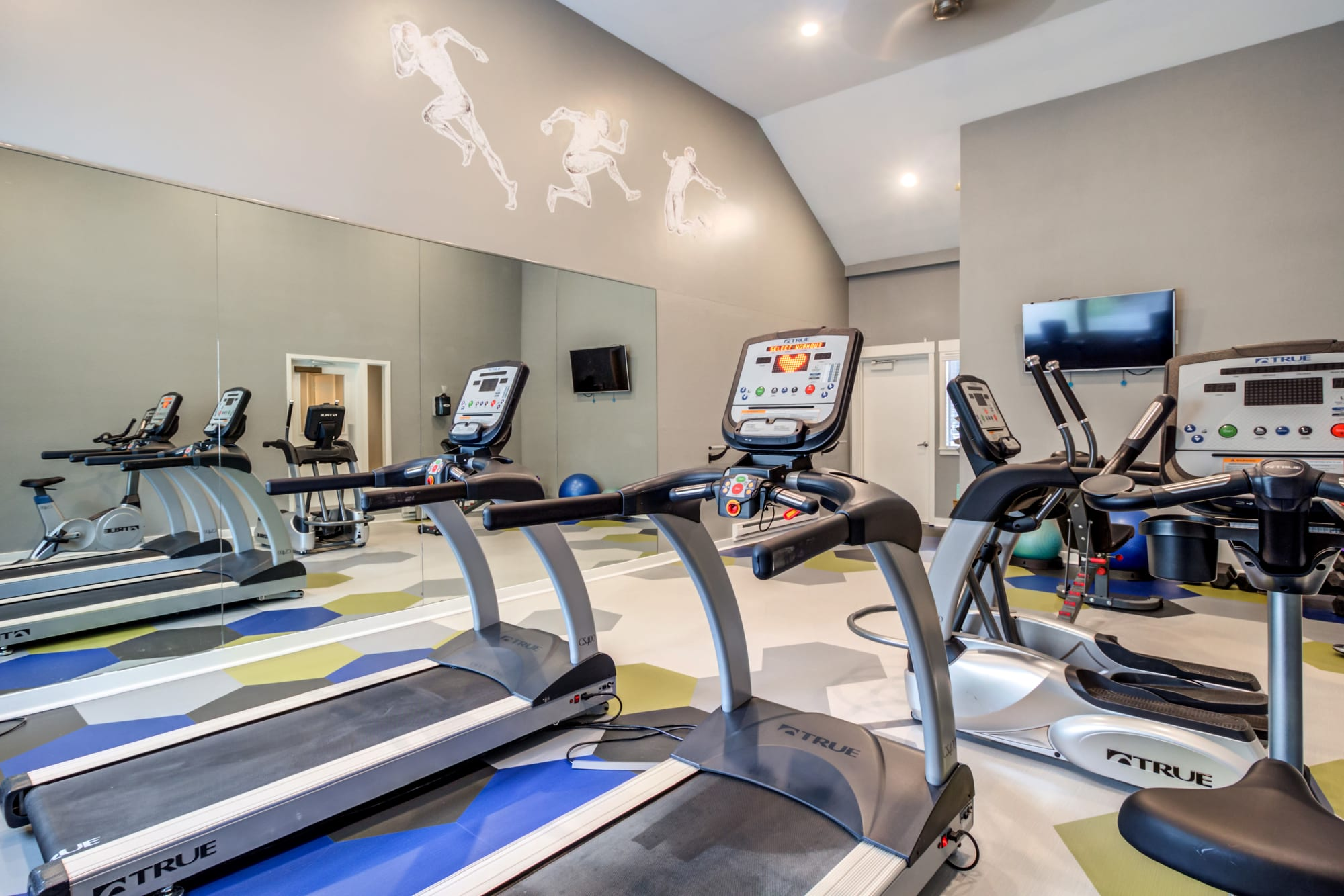 fitness center with cardio machines and weights