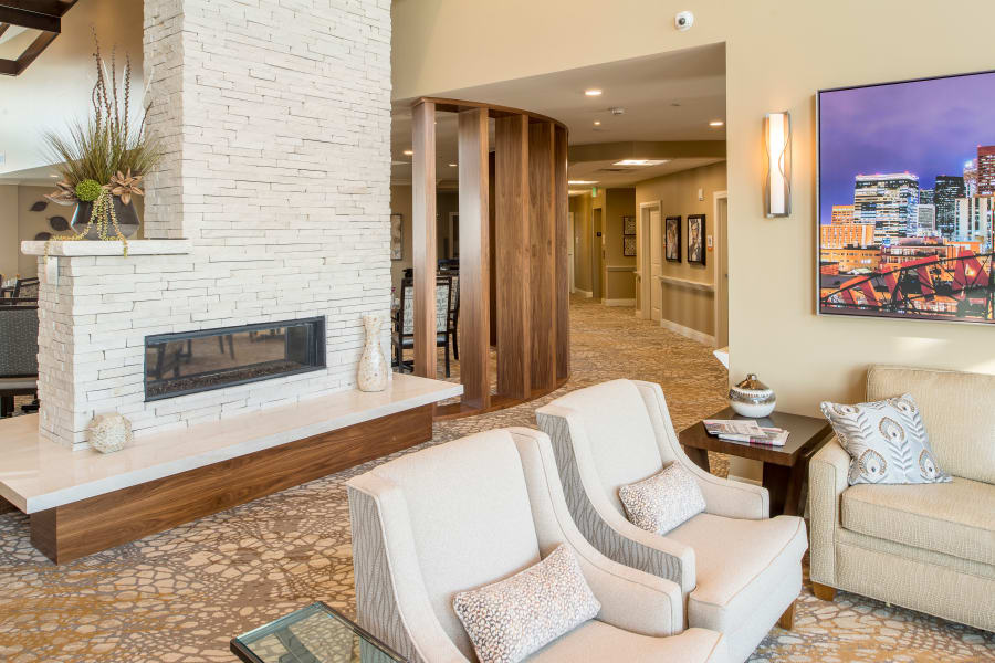 Fireplace in common area living room at Village at Belmar
