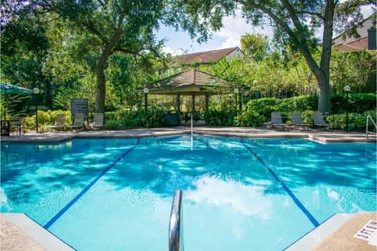 Resort-style swimming pool at 1801 MetroWest in Orlando, Florida