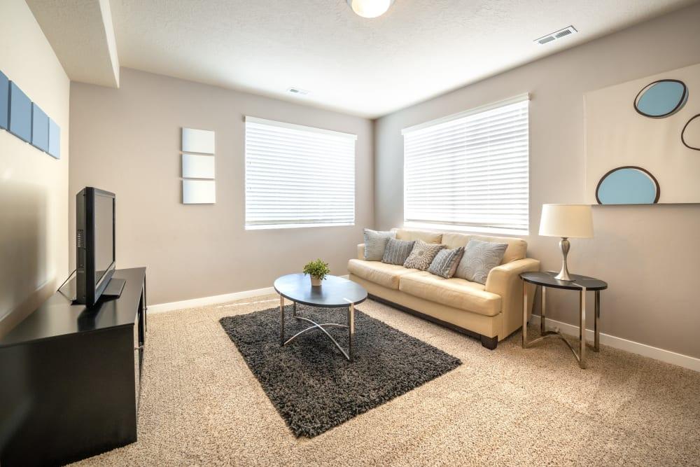 Model living room at Olympus at the District in South Jordan, Utah