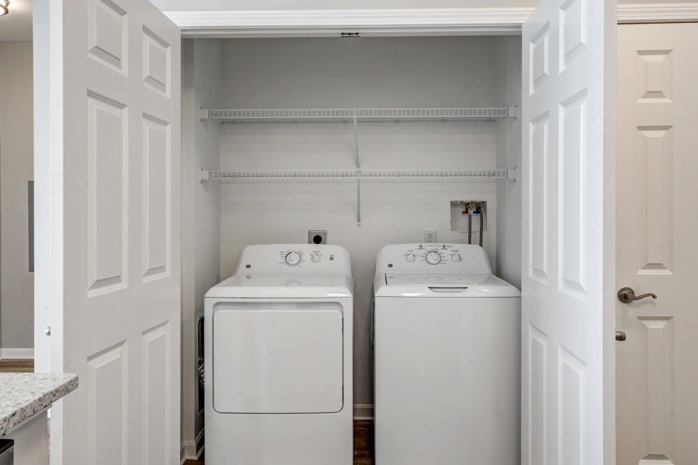 Laundry closet in a unit at apartments in Canton, Massachusetts