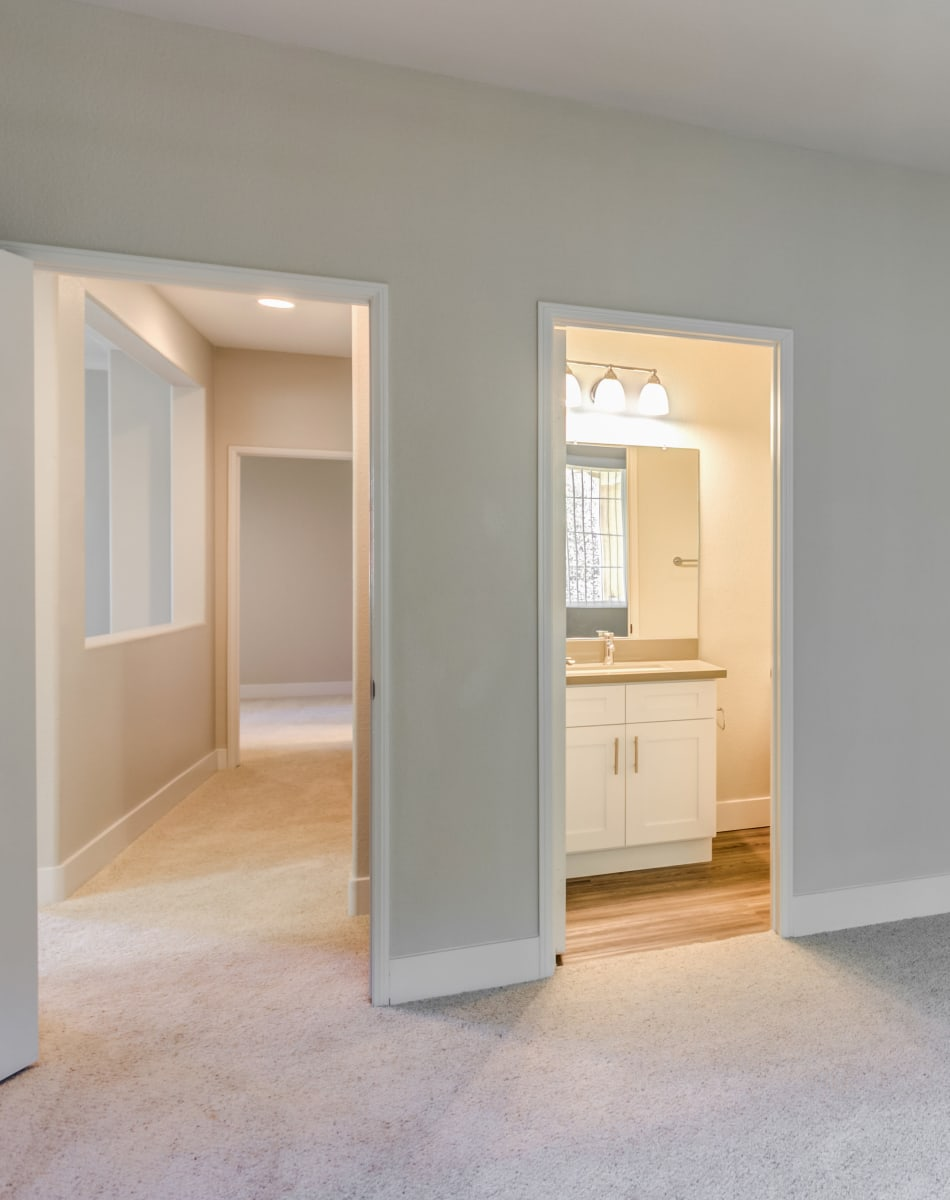 View of the hallway and en suite bathroom from a model home's bedroom at Sofi Westview in San Diego, California