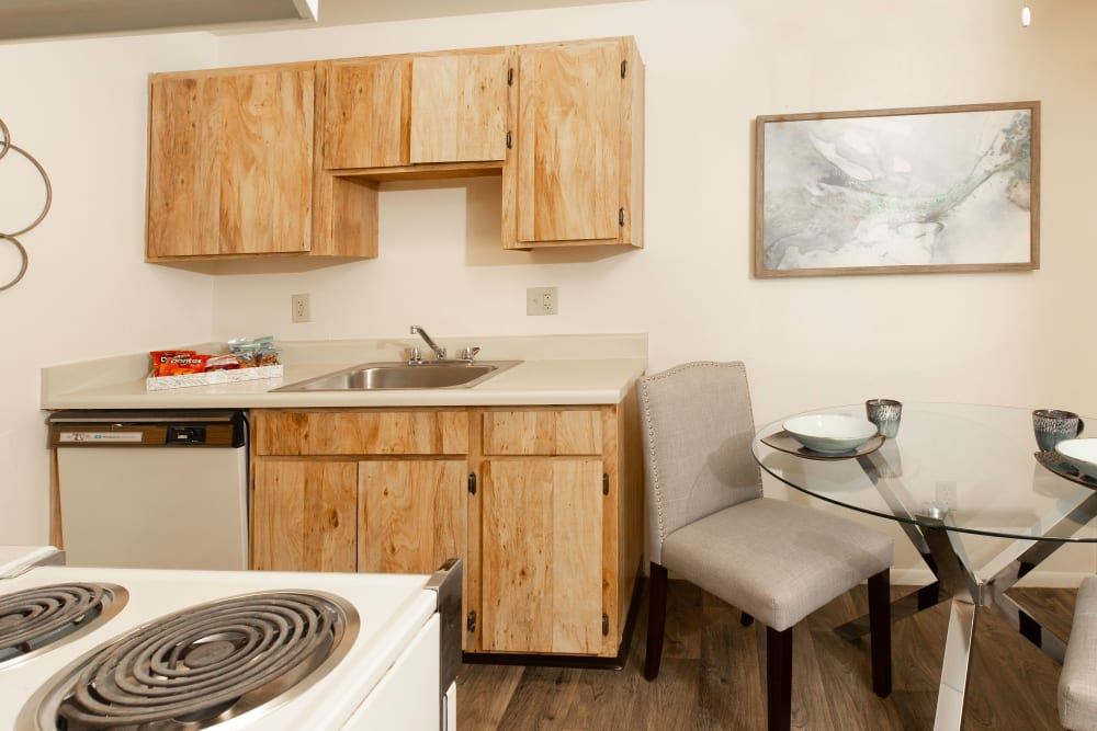 Kitchen with plenty of cabinet space and dining room at Callaway Apartments in Taylorsville, Utah