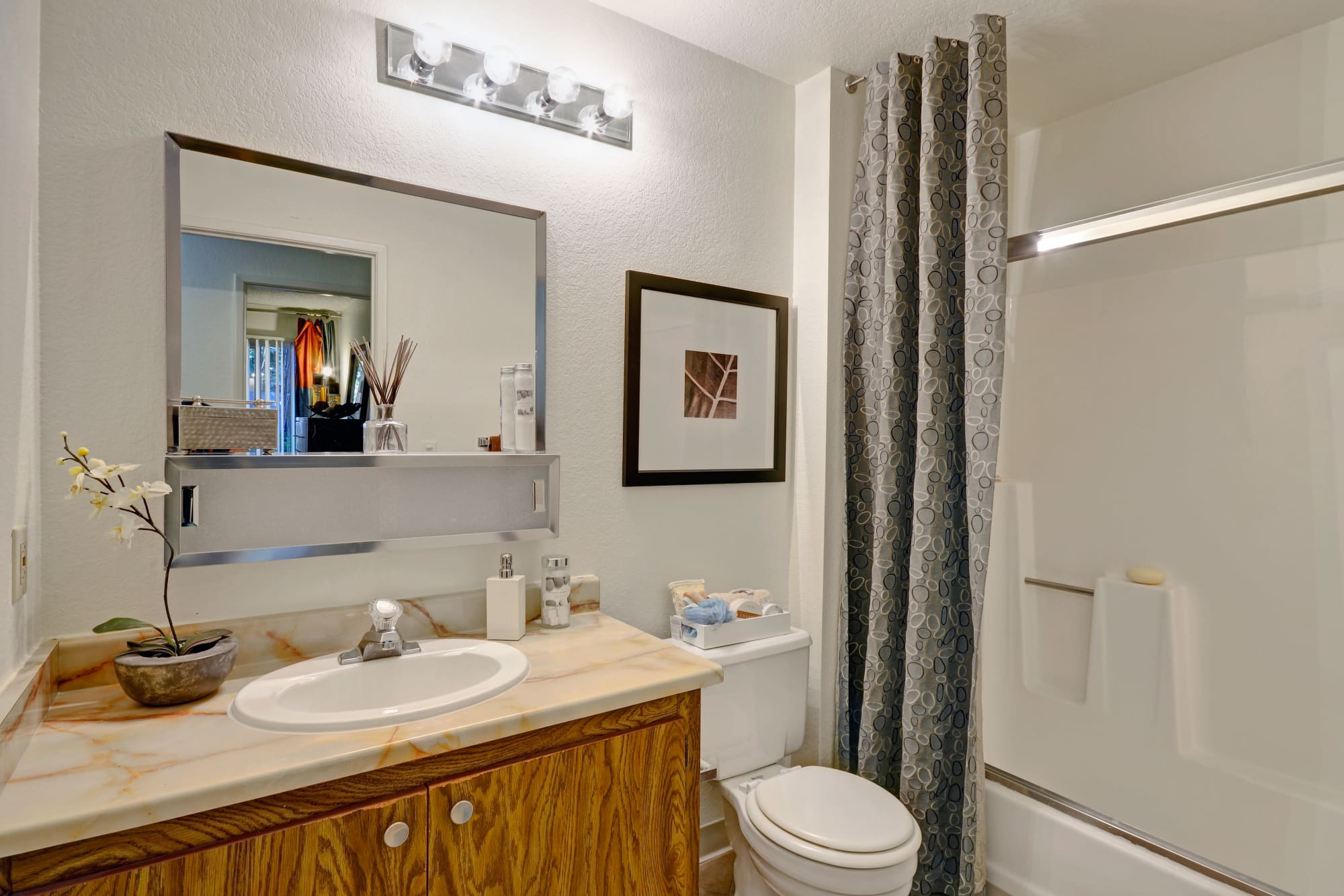 Avery Park Apartments offers nice bathrooms with large mirrors and tub