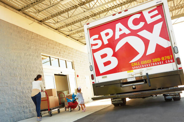 A family moving using the free moving truck at Spacebox Storage Crestview in Crestview, Florida.