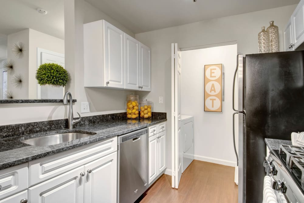 Kitchen with stainless steel appliances at Ellington Metro West in Westborough, Massachusetts