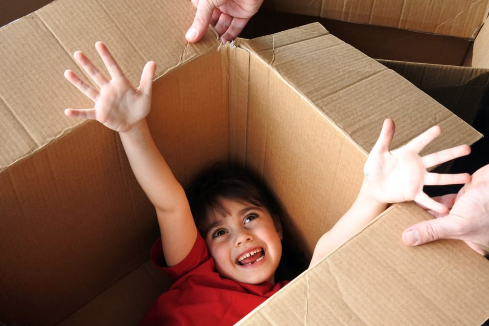 Kid playing inside a box at Summit Self-Storage in Victor, Idaho