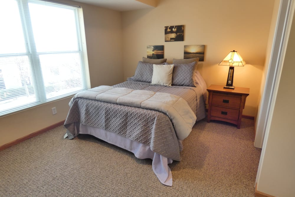 Spacious resident bedroom at The Lakeside Village in Panora, Iowa.