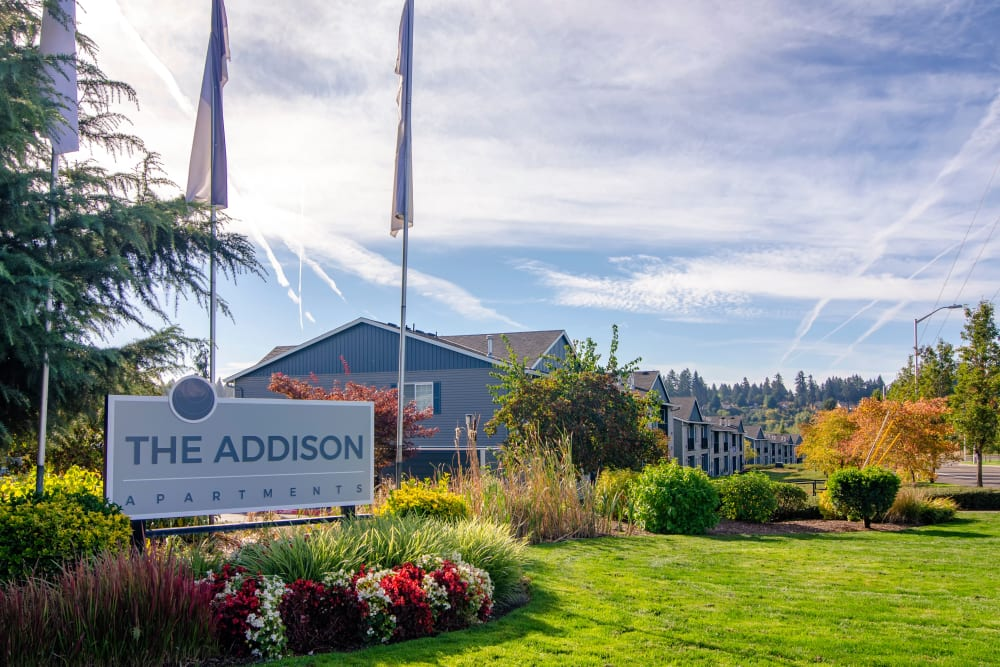 The front sign on a sunny day at The Addison Apartments in Vancouver, Washington