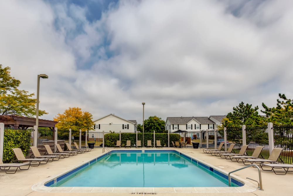 Swimming pool with a large sundeck at Lakeview Townhomes at Fox Valley in Aurora, Illinois