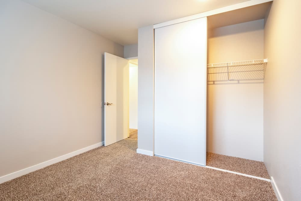Bedroom and closet space at Walden Pond Apartments in Everett, Washington