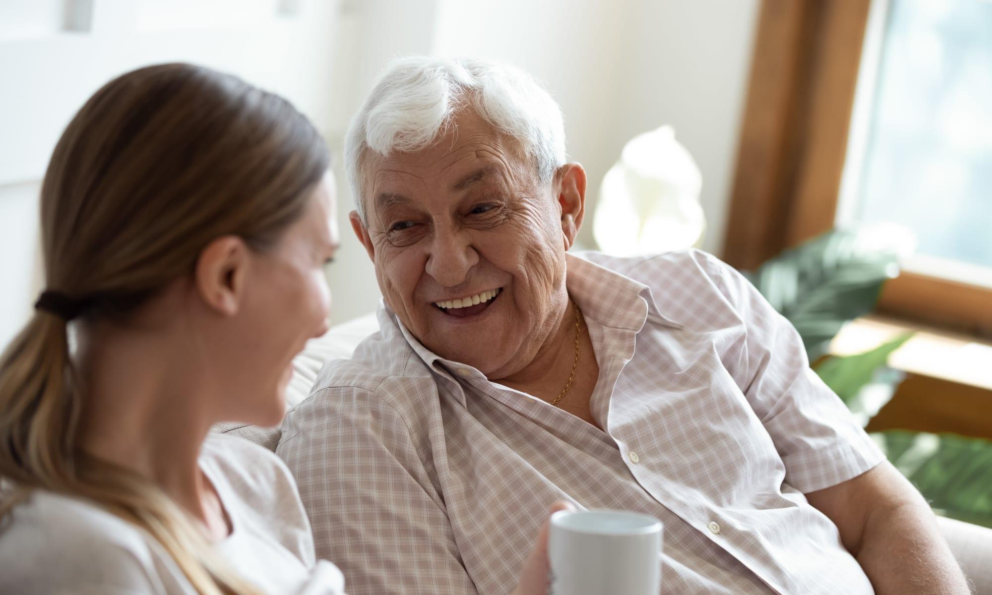 Grandfather and granddaughter chatting at Broadwell Senior Living in Kearney, Nebraska