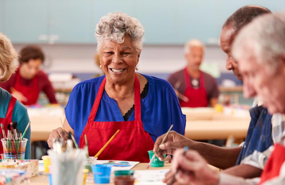Resident working on arts & crafts with a group at York Gardens in Edina, Minnesota