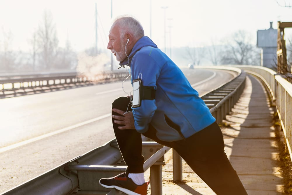 Senior man jogging in city near Marian Towers in Hoboken, New Jersey