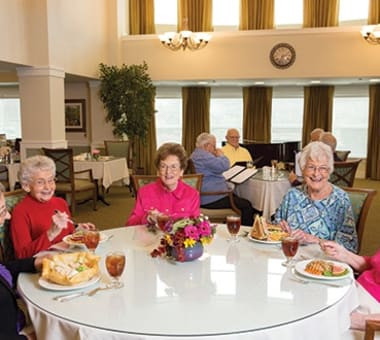 Seniors enjoying a meal together at Burr Ridge Senior Living in Burr Ridge, IL