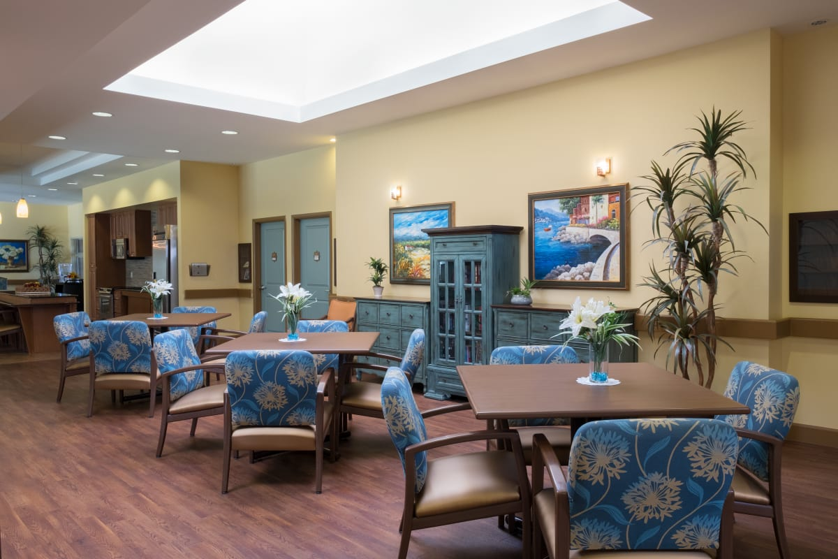 Kitchen and dining area at Avenir Memory Care at Chandler in Chandler, Arizona.