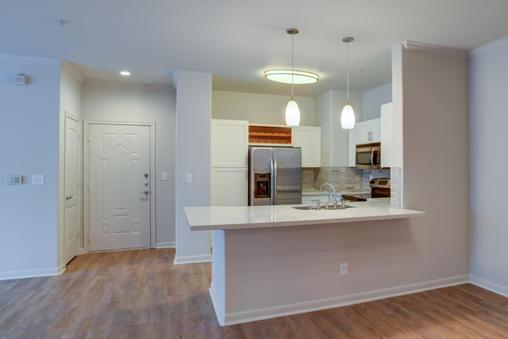 Open floor plan with remodeled modern kitchen at San Paloma Apartments in Houston, Texas