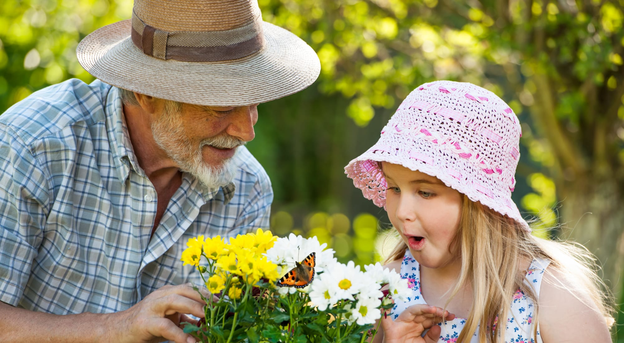 Resident and granddaughter picking flowers out near Sundial Assisted Living