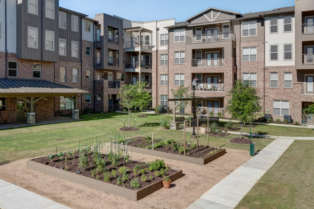 A garden in front of the building at Watercrest at Katy in Katy, Texas