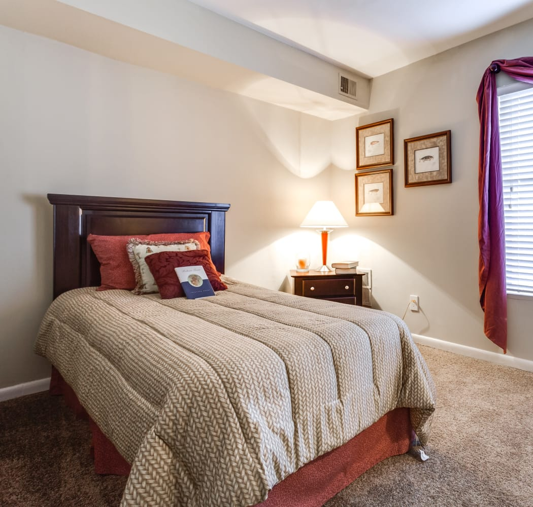 Well-lit bedroom at Villages of Lake Boone Trail in Raleigh, North Carolina