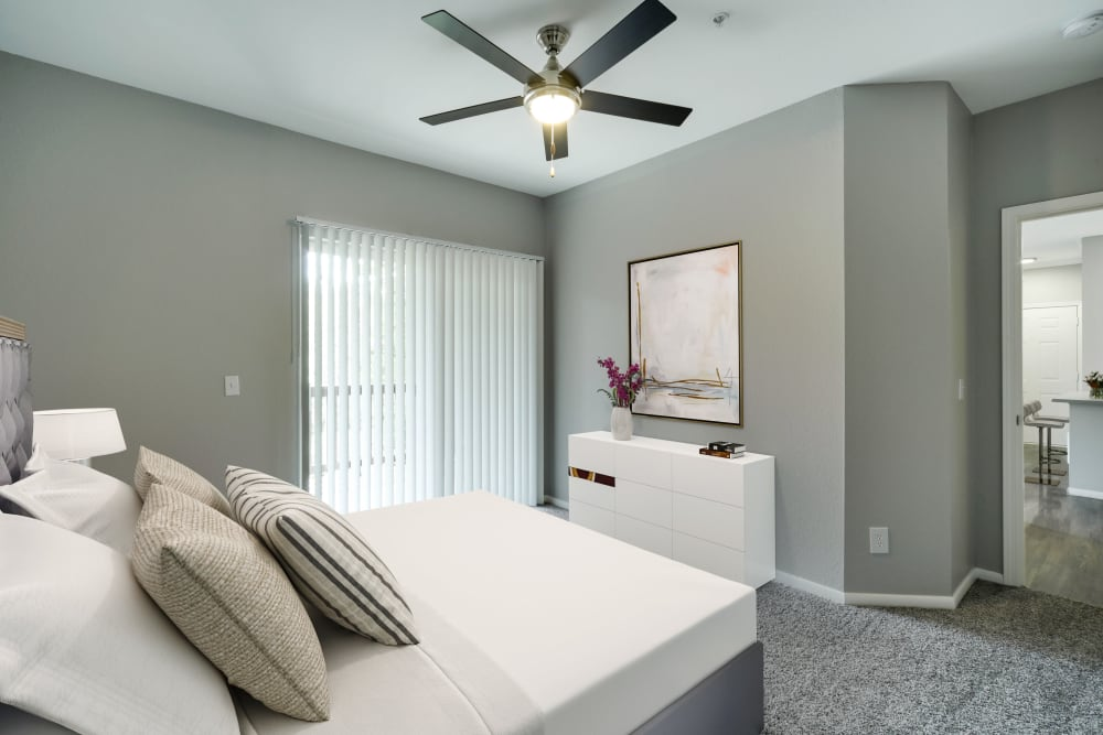 Large bedroom with a ceiling fan at The Grove at Orenco Station in Hillsboro, Oregon