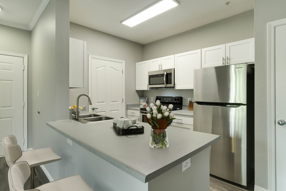 A kitchen with plenty of cabinet space at The Grove at Orenco Station in Hillsboro, Oregon