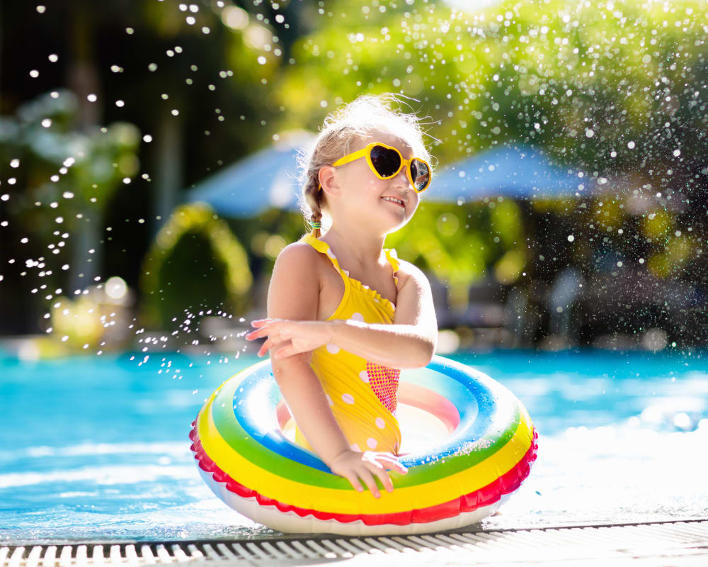 New resident enjoying the swimming pool on a hot day at Northwind Apartments in Reno, Nevada