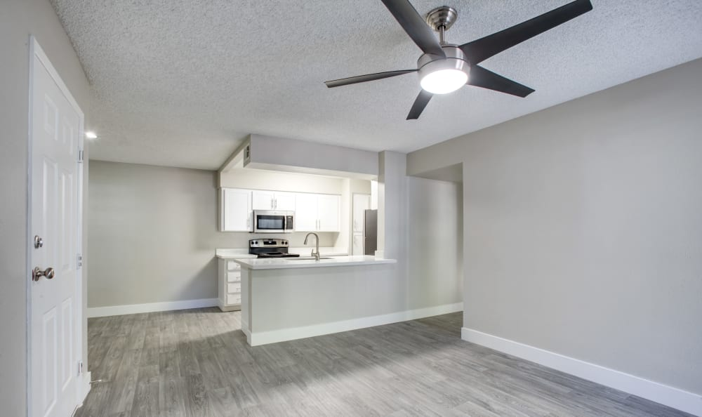Spacious living room and kitchen at Elliot's Crossing Apartment Homes in Tempe