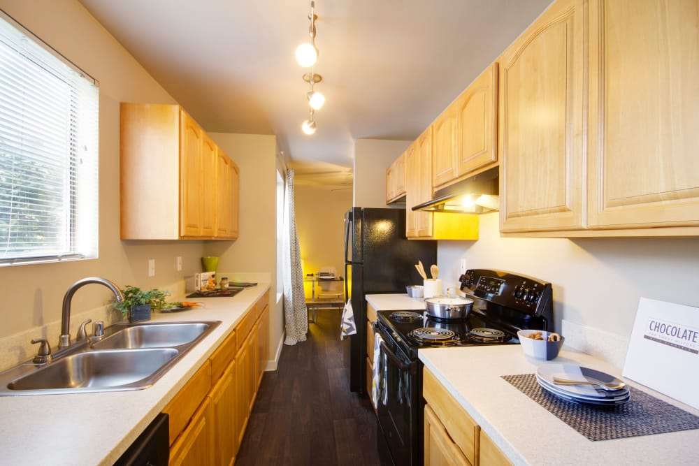 Modern kitchen featuring wooden cabinetry at The Carriages at Fairwood Downs in Renton, Washington