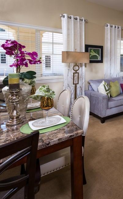 Dining table and cozy living room at Estancia Del Sol in Corona, California