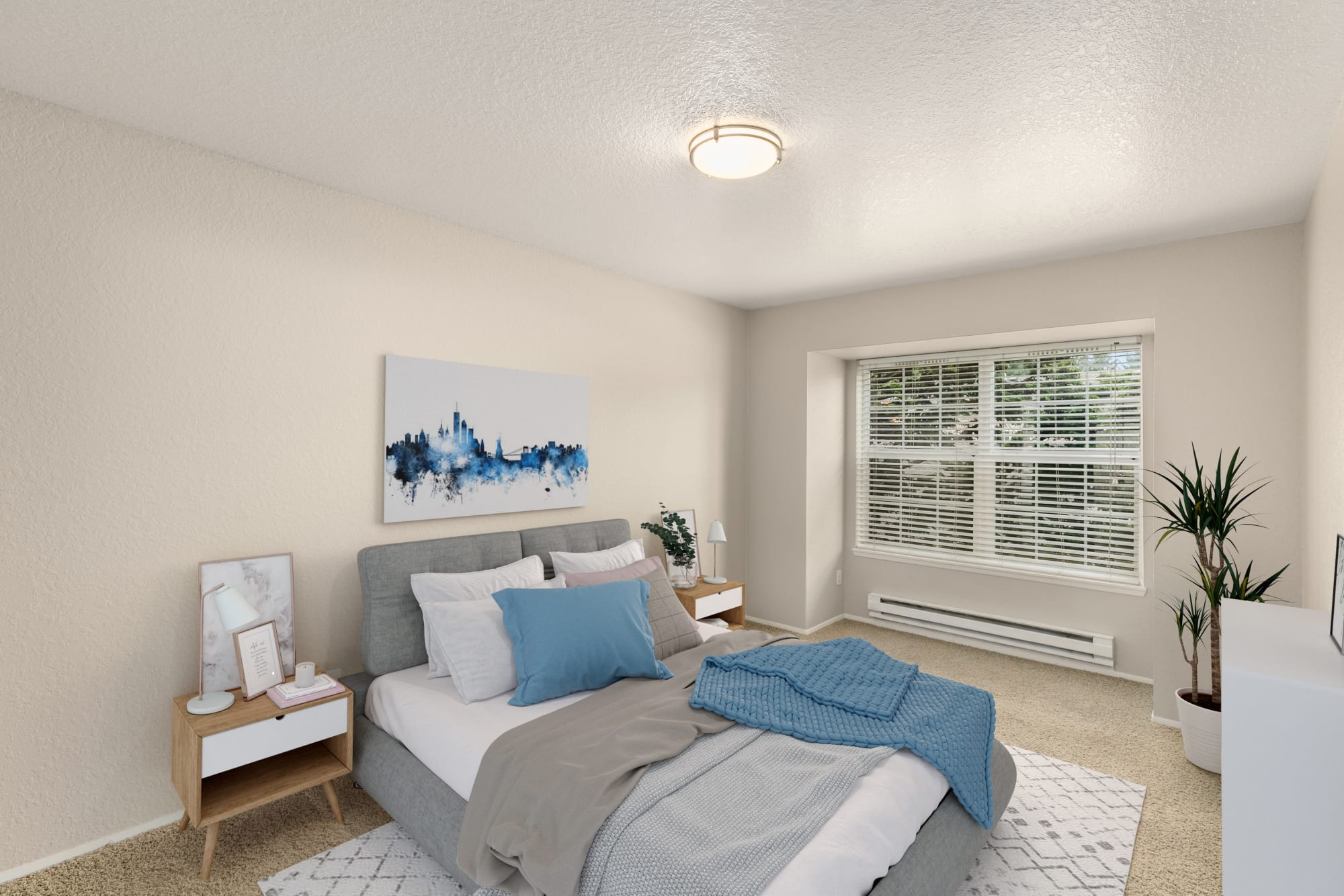 Spacious bedroom with a large window at Carriage Park Apartments in Vancouver, Washington