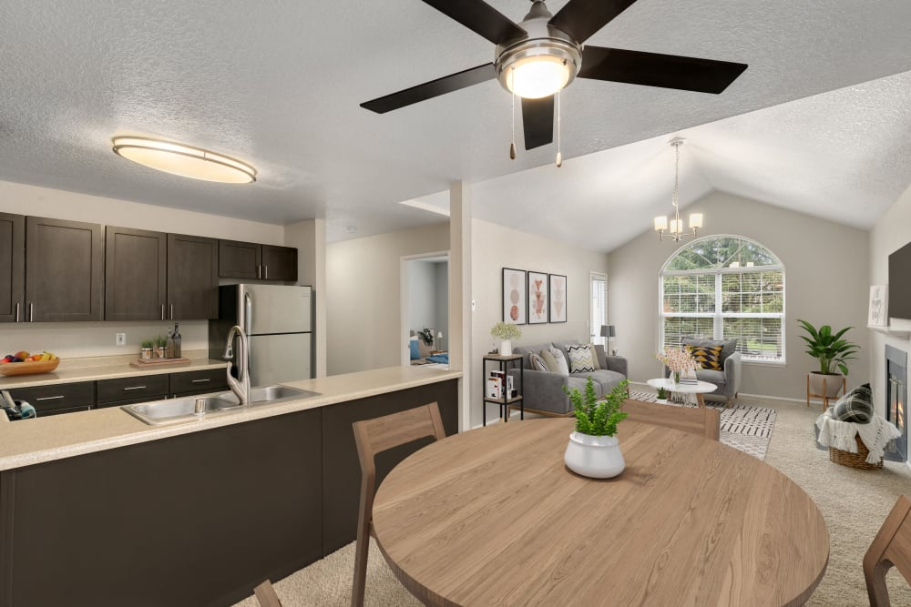 A beautiful open layout floor plan with the kitchen overlooking the living room at Carriage Park Apartments in Vancouver, Washington