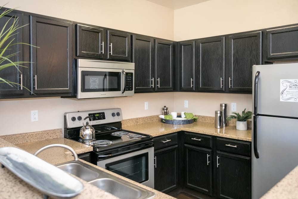 A kitchen with plenty of cabinet space at Westridge Apartments in Aurora, Colorado