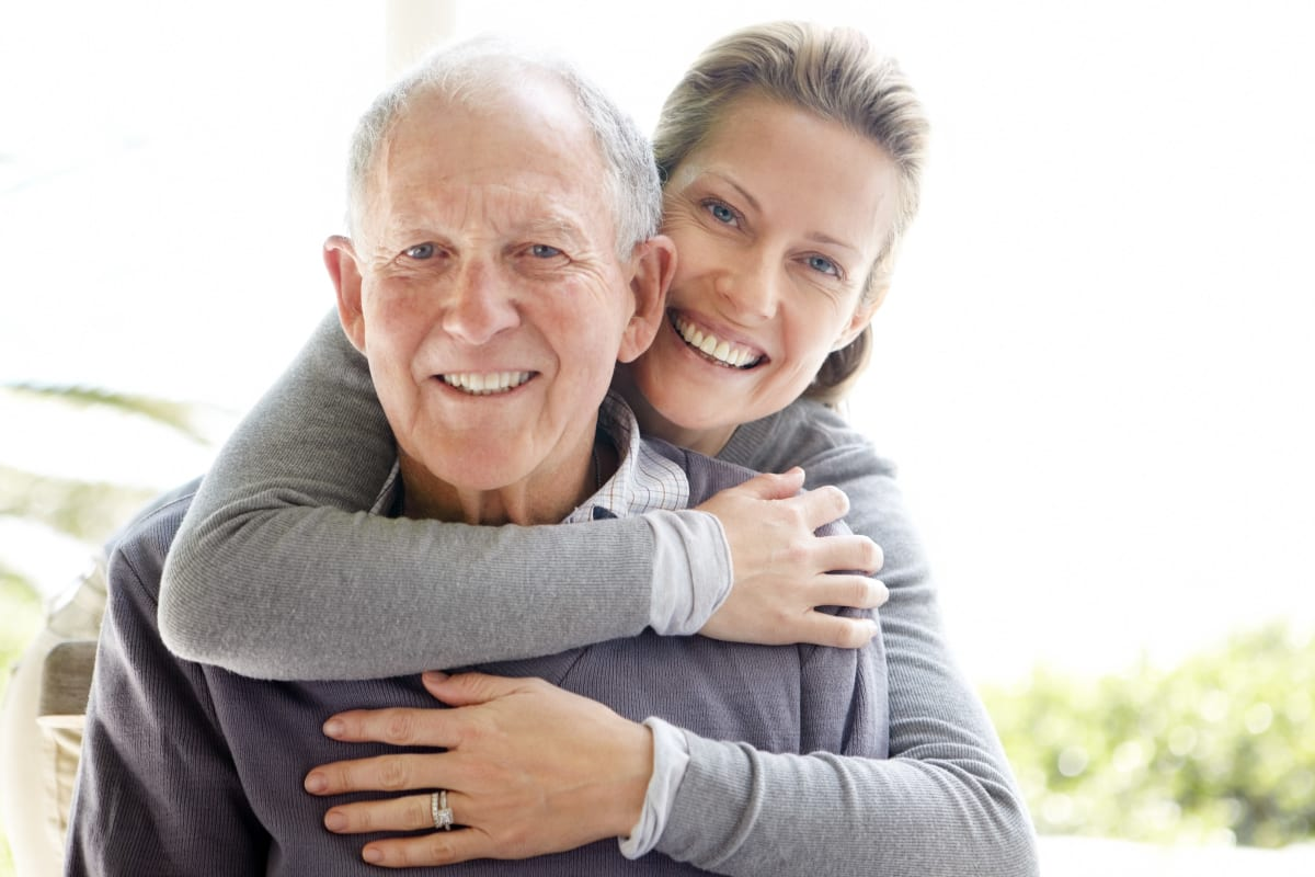 A family member visiting a relative at Estancia Senior Living in Fallbrook, California