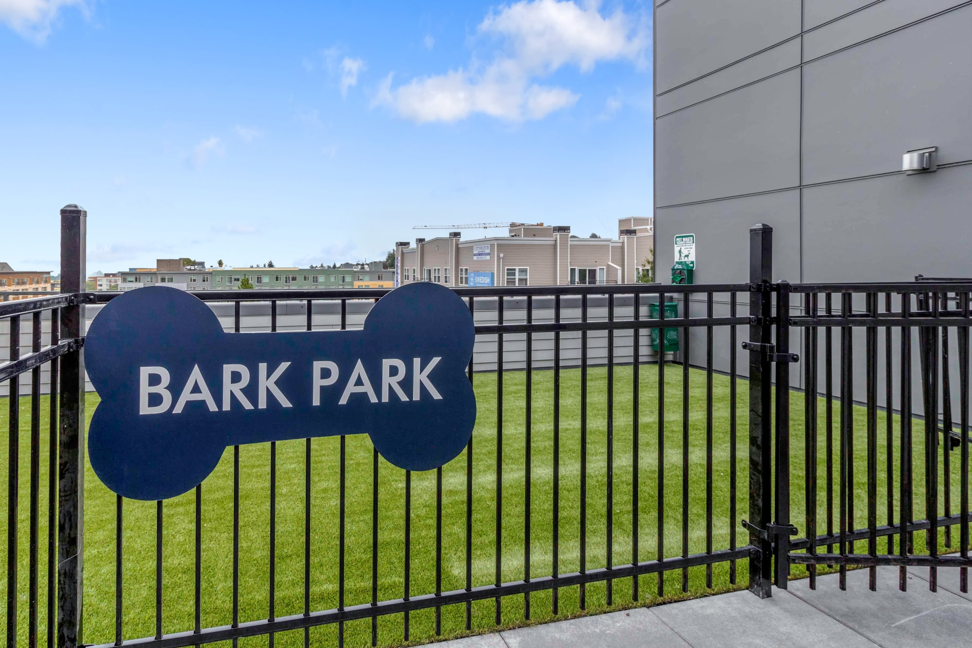 The onsite dog park makes it easy to take care of your buddy at Elan 41 Apartments in Seattle, Washington