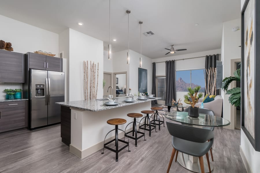 Upgraded kitchen with granite counter tops  at The District at Scottsdale in Scottsdale, Arizona