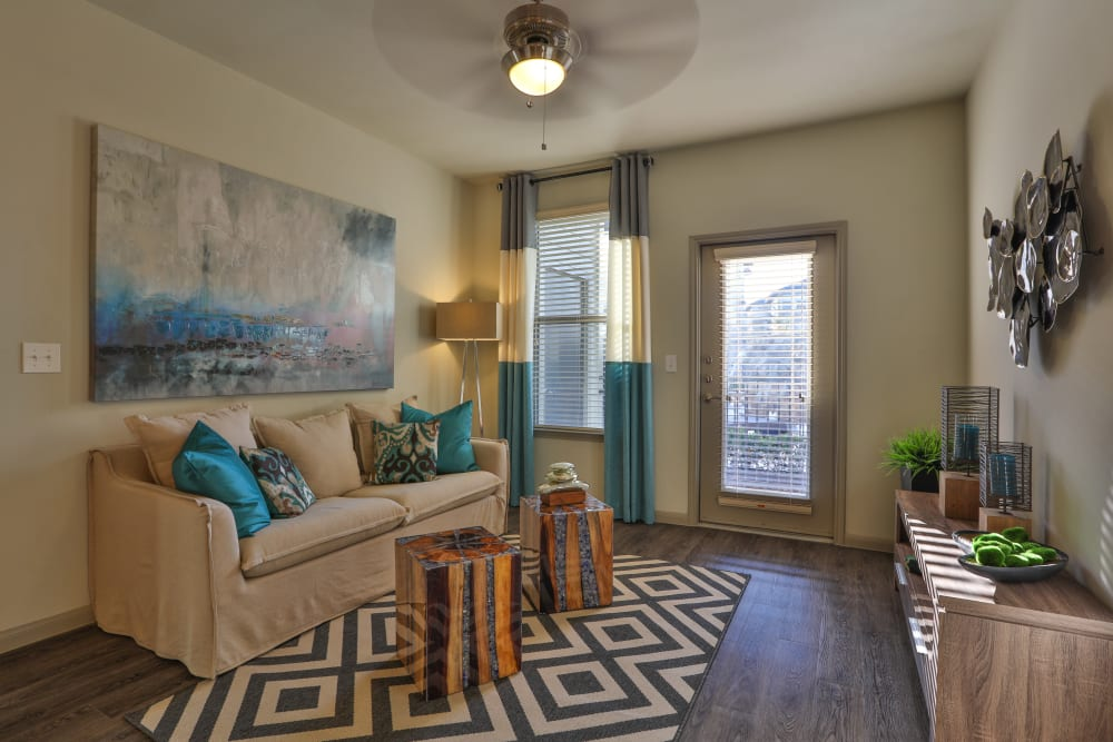 Model living room at Olympus at Waterside Estates in Richmond, Texas