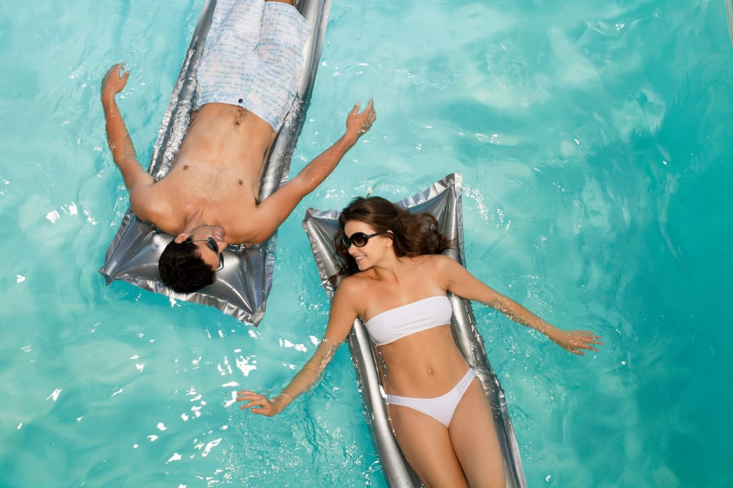 Young couple relaxing in the pool at Casa Tierra in Albuquerque, New Mexico