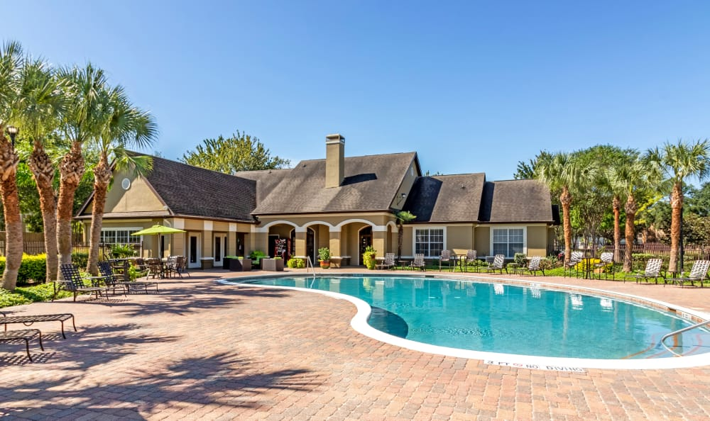 Sparkling pool with lounge area at Kenwood Club at the Park in Katy, TX