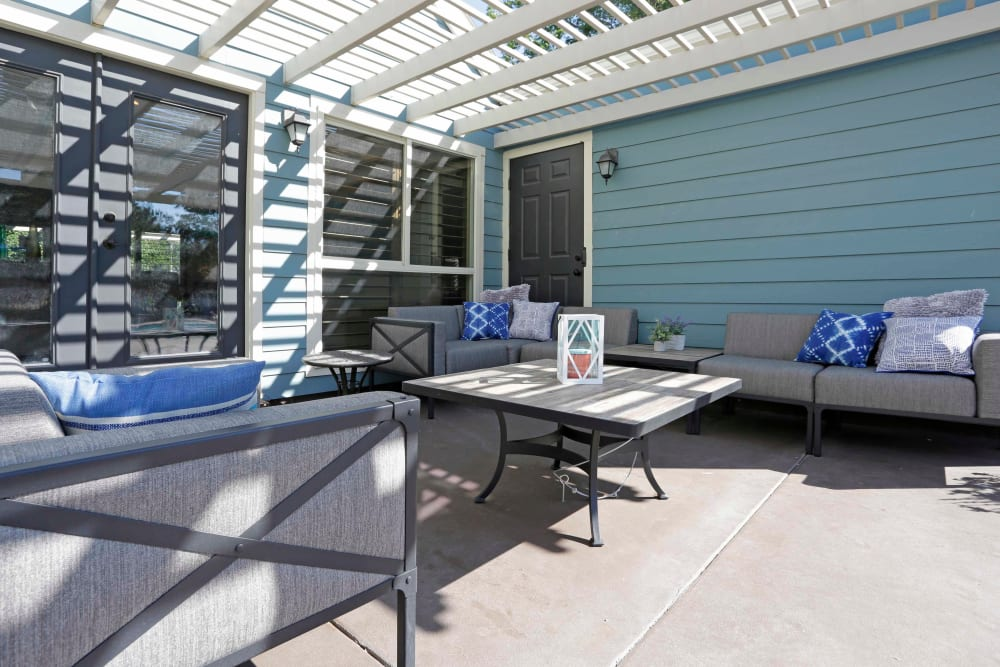 Outdoor lounge area with couches at Royal Ridge Apartments in Midvale, Utah